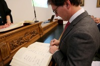 Signing the book of obligation